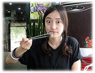 Picture of young Korean woman at a restaurant - Bild einer jungen Koreanerin im Restaurant