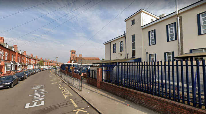 English Martyrs' Primary School with the church in the background - image from Google Maps Streetview