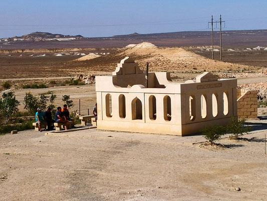 Beten vor der Grabstelle