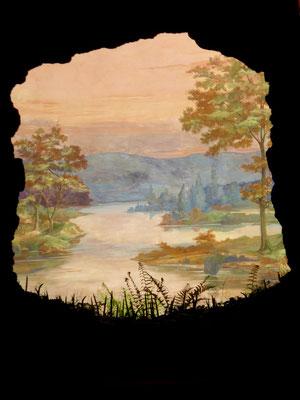 Die Freskomalerei des Weltendes schließt die Parklandschaft beim Ensemble des Badhauses nach Norden ab.