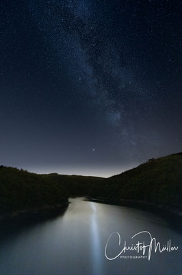 The Milky Way and it's reflection in the artificial lake of Esch/Sûre in Luxembourg together with Saturn and Jupiter