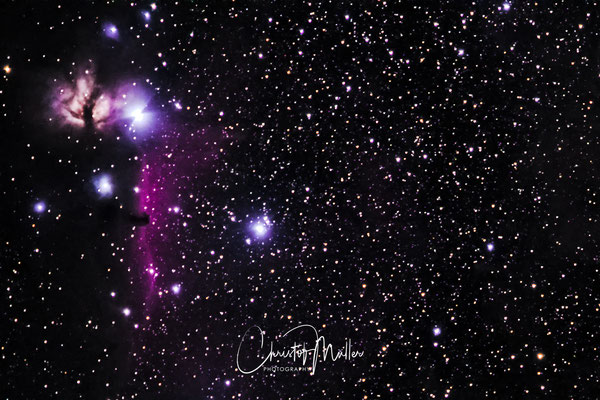 The Horsehead Nebula and the Flame Nebula shot with a mirrorless digital camera and 200 mm lens (stacked and cropped)