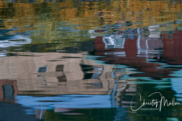Reflection of traditional houses of the small town of Hoonah