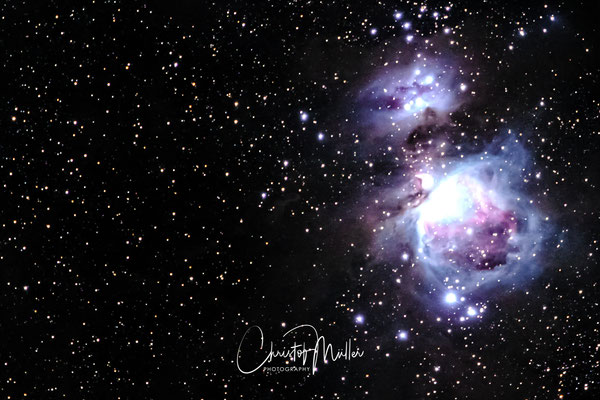 The Great Orion Nebula (M42) and the The Running Man Nebula (NGC1977) shot with a mirrorless digital camera and 200 mm lens (stacked and cropped)
