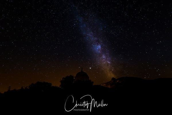 The Milky Way above  a large white domed mausoleum at Palasca Corsica, France