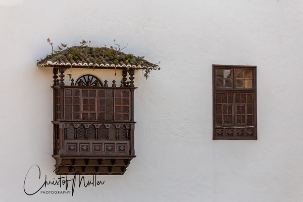 Traditional white house with wooden balcony in Icod de Los Vinos