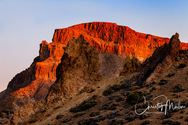 Alto de Guajara brightly illuminated of the last rays of the evening sun at the golden hour in El Teide National Park, Las Cañadas del Teide.