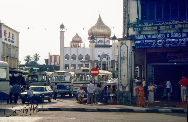 Jalan Masjid Bus Station with the Old State Mosque or Kuching Mosque in the background.