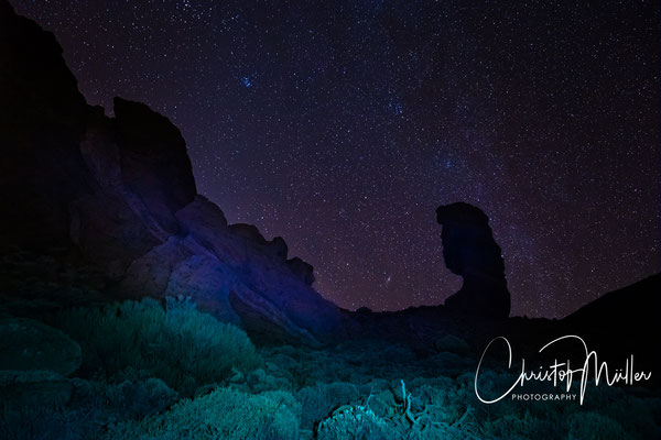 Starry night above the iconic Roque Cinchado in Tenerife, Spain in Teide National Park.