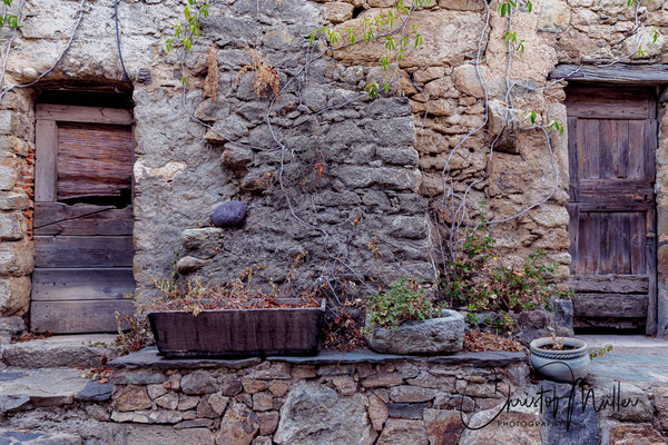 A natural stone facade on an old house in the small village Palasca, 350 meters above sea level.