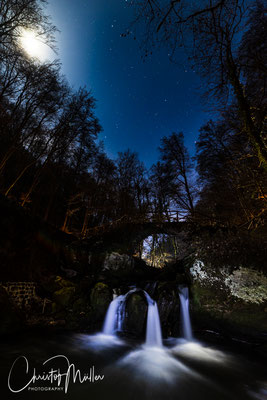 """The """"Schiessentümpel"""" in Luxemburg - Mullerthal. A picturesque 140 years old stonebridge above a small waterfall taken by night and full moon. Fullframe 14 mm Iso 400 30 sec f 5.6"""