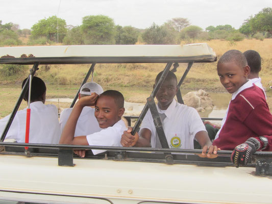 Students in the typical observation stand of a Safari vehicle.