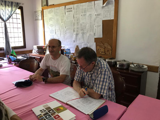 Mr. Sommer and Dr. Bauer with the Visitors Book of the School in the office of our Headmaster.