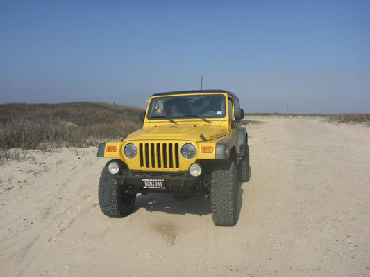 Jeep driving on the beach