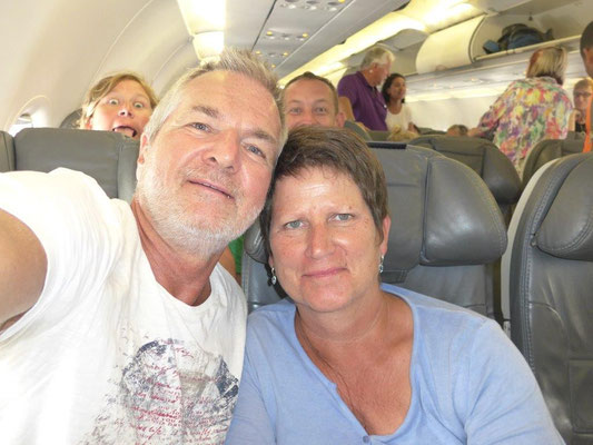 Selfie on the flight back, watch the folks behond us.......