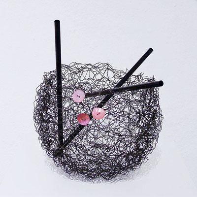 Nest mit Knöpfen