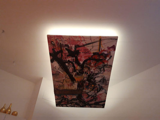 This buyer found a new way of displaying this large scale paintings. She had it installed on the ceiling with lightning around it.