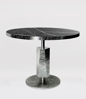 Aluminum hammered table for Dior