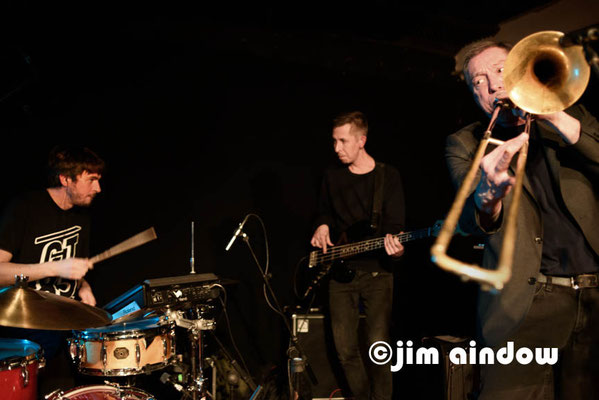 "Tom Skinner on drums, Leon Britchard on bass & Peter Zummo on trombone. Launch of Hello Skinny's new album ""Watermelon Sun', Total Refreshment Centre, London 17.1.18"