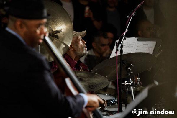Essiet Okon Essiet on bass, Victor Lewis on drums