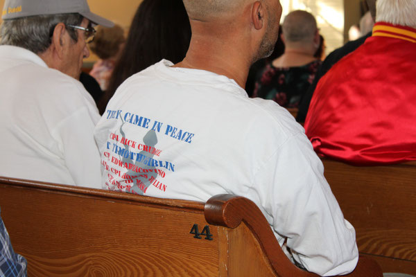 """They Came In Peace"" shirt worn by family member of Sergeant Timothy Giblin"