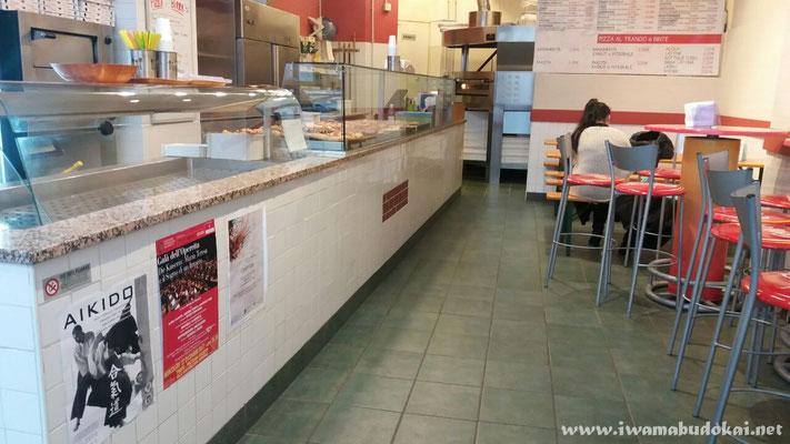 La locandina IBK esposta nei locali della pizzeria La Napa XXX Ottobre.