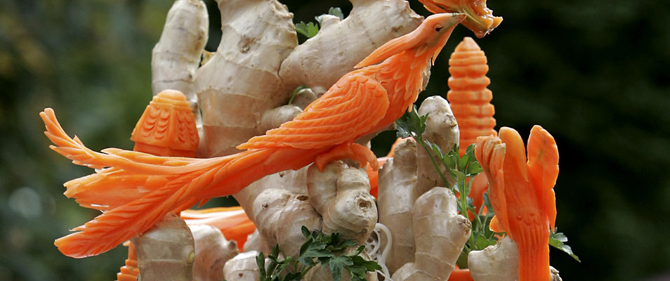 Ornate bird carved from carrots