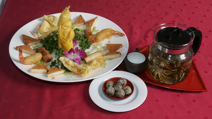 Variation of delicious dim sum with our tea speciality China Special Jasmin Silvery Strawberry (ball)
