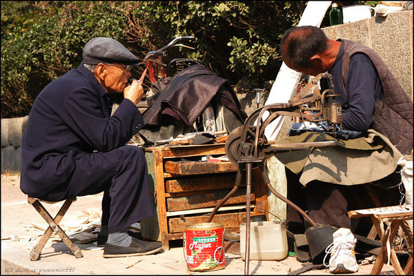 A shoe repairer and tailor along the road, Tai'an