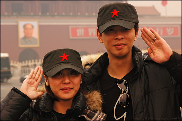 Young couple and Mao in Tian'anmen Square, Beijing