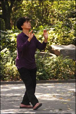 A lady practising Tai Qi in Tianshan Park, Shanghai