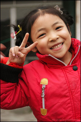 A cute and happy kid in Wudangshanzhen, the closest railway station for Wudangshan