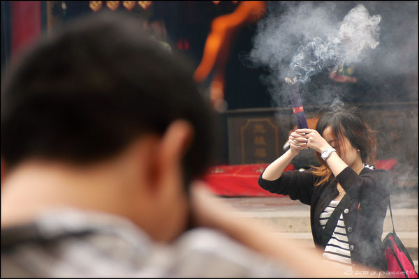 Devotees burning incense at the Jade Buddha Temple, Shanghai