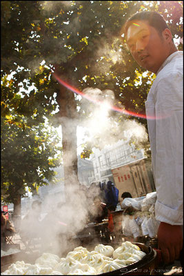 Fresh dumplings, steam and the chef, Qufu