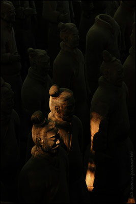 Soldiers lit by a ray of sunlight at the Terracotta Army
