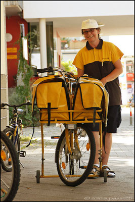 Postwoman by bicycle in Vauban