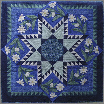 Wall quilt with hand applique