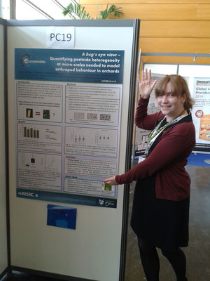 Jo proudly presenting her poster.