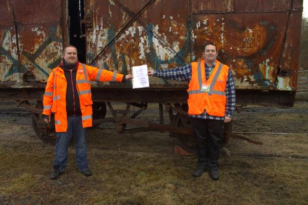 Llanelli and Mynydd Mawr Railway Chairman Mark Thomas and Museum Founder Aaron Matthews exchanging agreements.
