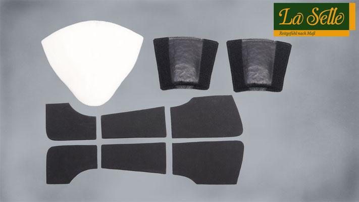 1: großes Schaumkissen zur Aufpolsterung bzw. Erhöhung des Sitzbereiches     2: Einlagen in 1 + 2 cm für den vorderen Sitzbereich zur Anpassung der           Sitzposition      3: drei Mossgummieinlagen - vorn, mittig und hinten, zum genauen Anpassen