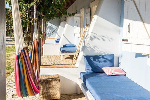 relaxing outdoor space with hammocks and sun beds