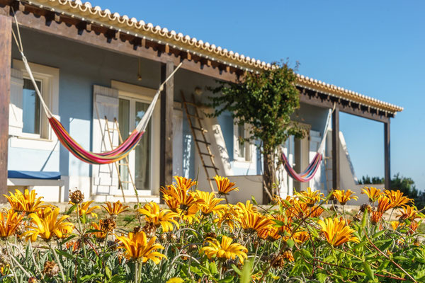 flowers in front of your room lets yoga retreat portugal