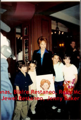 The cast celebrates as Reba gets her characature on the wall at the NYC restaurant Sardi's. May 23rd 2001