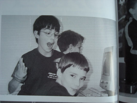 Joe doing something weird with a couple of friends and the ol' computers we all remember and hate. ECMS. Grade 6, 2002.