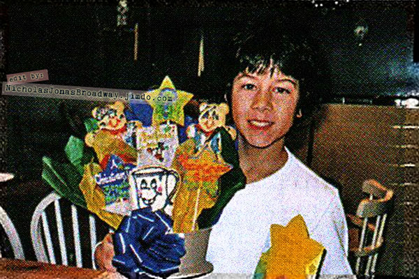 Nick gets a cookie bouquet for his tenth birthday from Shirley Grant! - Credit Jonas family  // Edited and put together by the NJB team!