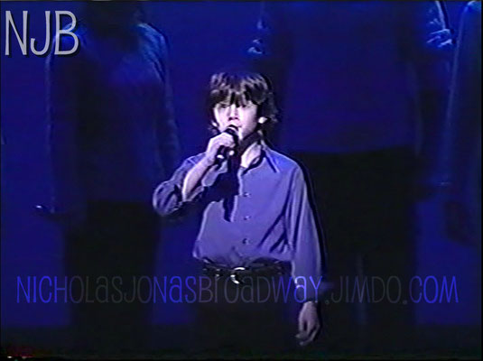 "Nicholas singing his opening solo during ""Someday"" at the 2001 Gypsy of the Year - Credit NJB"