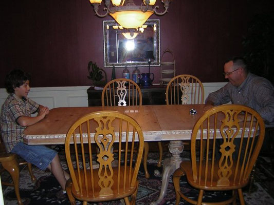 Nick playing a game with Mandy's father.