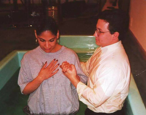 Pastor Kevin Jonas christening a girl at Wyckoff Assembly of God, 1996.