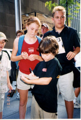 Signing some autographs after a matinee performance. He is wearing his AGYG cast shirt, it says 'Annie Get Your Gun' on the front and 'There's no Business Like Show Business' on the back. July 22nd, 2001. - credit nicholasjonas.com