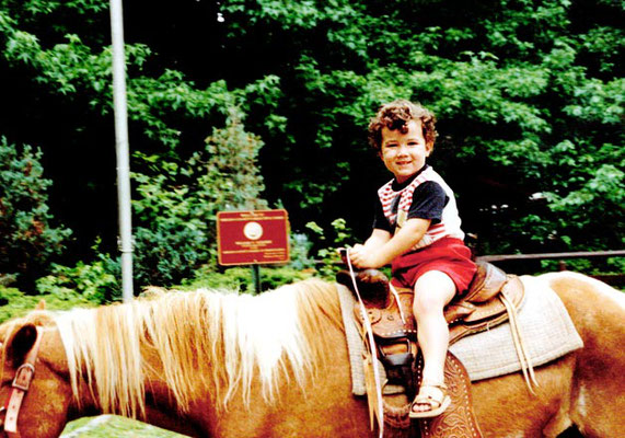 3 year old Kevin riding a horse.